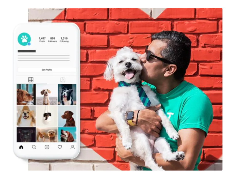 An image of a man snuggling a dog with a phone showing his business' Insta feed, created by GoDaddy giving him more time.
